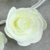 Ivory Foam Rose As Part Of The Garland