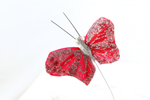 Our deep Red artificial Butterfly on a steel wire stem.
