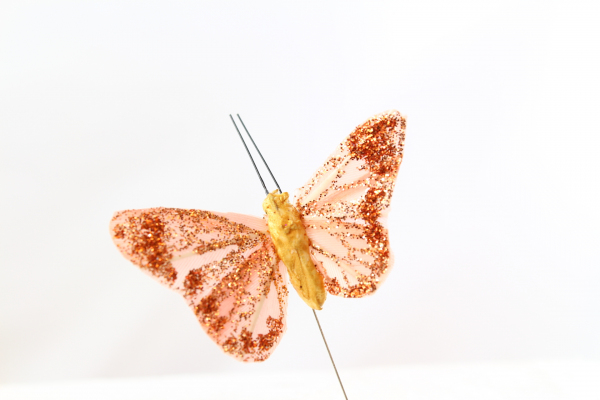 Our Gold/Bronze coloured Butterfly on a steel wire stem.