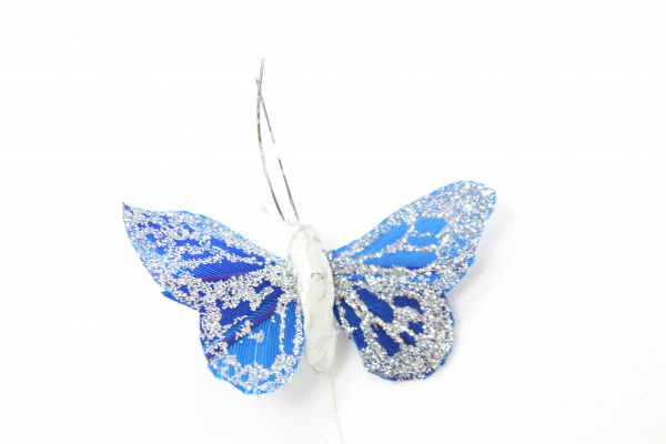 Royal Blue Coated Butterfly, With A Glitter Pattern On Surrounding the wings.