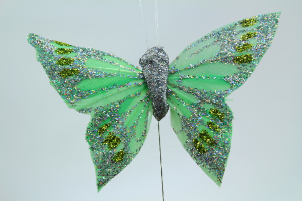 Green craft butterfly for decorating your wedding event.