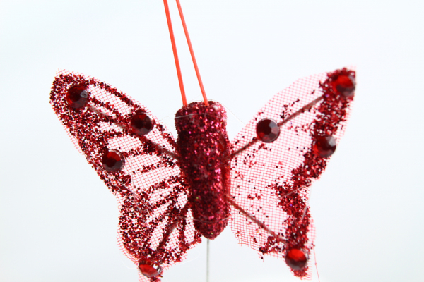 A red miniture Butterfly with 4cm wide wings.