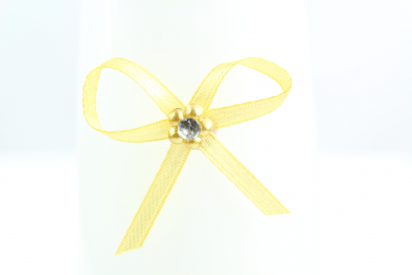 Our small suttle gold bow with adhesive pad