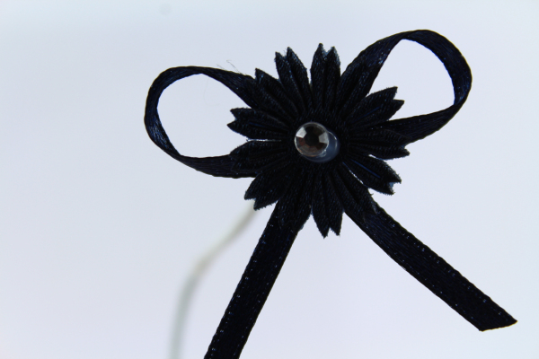 Our Navy daisy bow with diamonte center