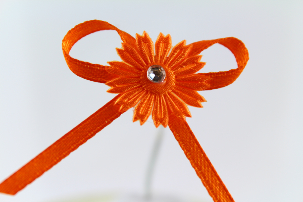 Our outstanding orange daisy ribbon bow
