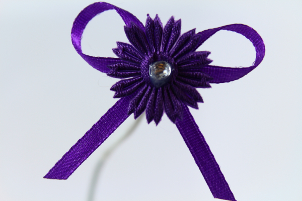 our deep purple craft bow with daisy design