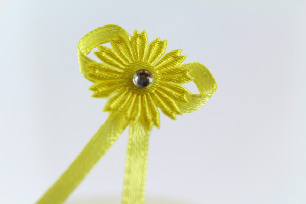 Our bright yellow daisy craft bow with diamonte center
